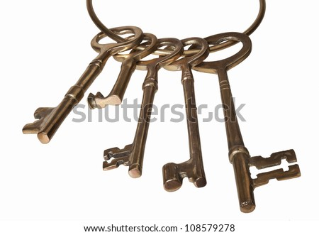 A set of antique keys isolated on white - stock photo