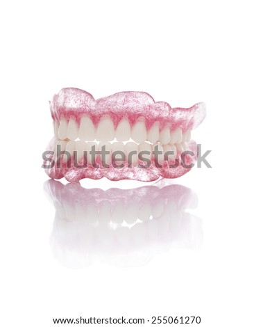 A Set of Artificial Dentures Isolated on White Background - stock photo