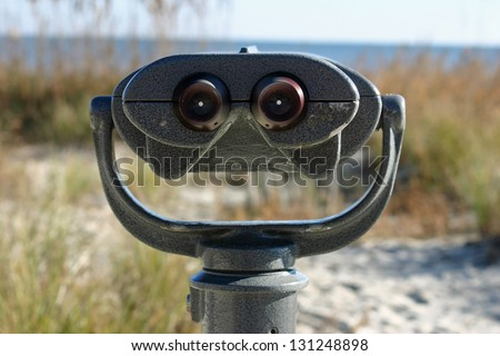 A set of binoculars at a public beach - stock photo