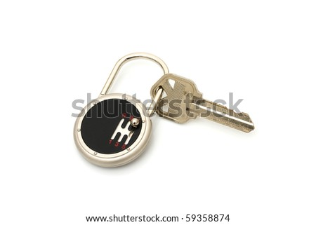 A set of car keys with a remote entry system isolated on white