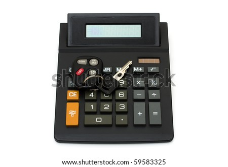 A set of car keys with a remote entry system on a calculator on white - stock photo