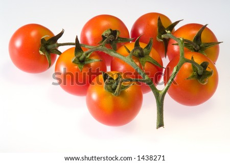 """A set of """"cherry"""" italian red tomatoes. - stock photo"""
