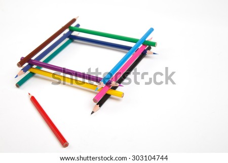 a set of children's colored pencils lying on a white background - stock photo