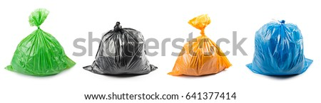 A set of colored garbage bags isolated on white background. Collage of garbage bags.
