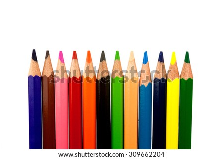 A set of colored pencils isolated against a white background