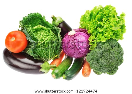 A set of colorful vegetables of cabbage, broccoli, zucchini and lettuce. On a white background. - stock photo