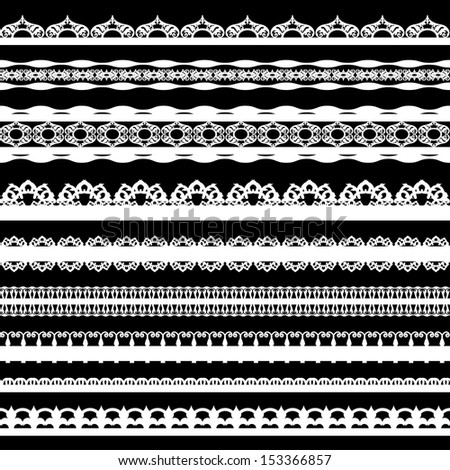 A set of cute white lace ribbons on a black background.