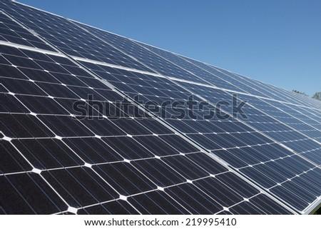 A set of dark blue solar panels - stock photo