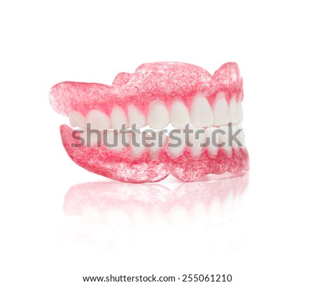A Set of Dentures Isolated on White Background - stock photo