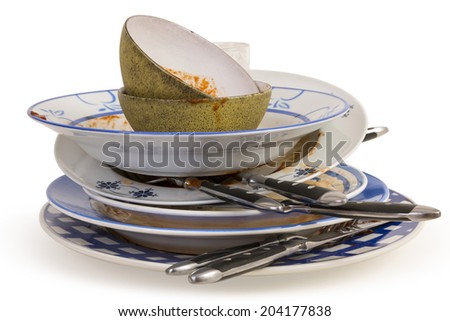A set of dirty dishes and eating irons on a white background. - stock photo