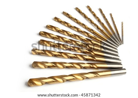 a set of drill bits of golden color - stock photo