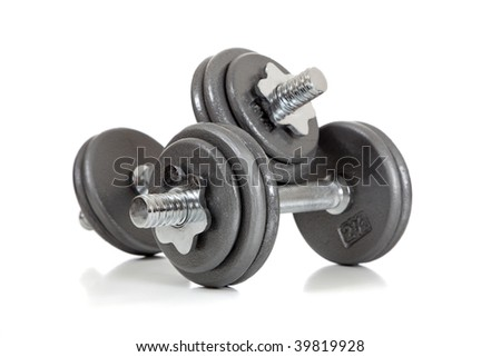 A set of dumbbells on a white background - stock photo