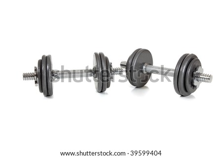 A set of dumbells on a white background - stock photo