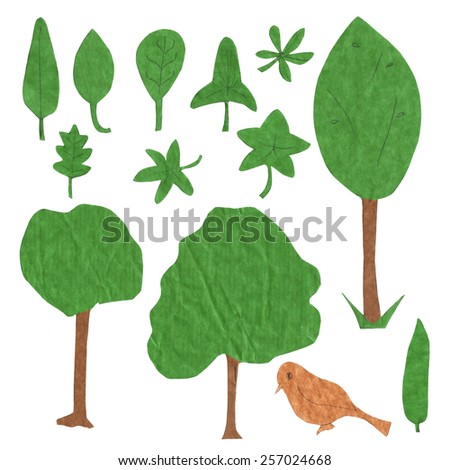 A set of ecologically themed isolated design elements cut out of green and brown paper - stock photo