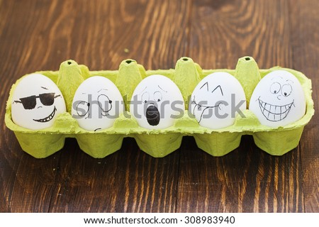 a set of eggs with faces drawn on them, various emotions - stock photo