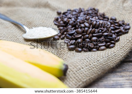 a set of fair trade products - banana, coffee beans and rice - stock photo