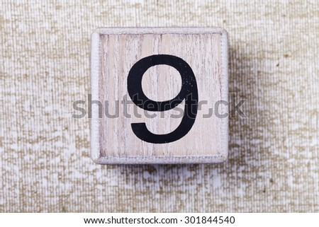 a  set of figures on wooden cubes 9 - stock photo