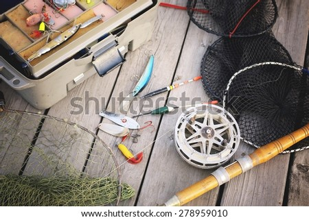 a set of fisherman on a wooden background - stock photo