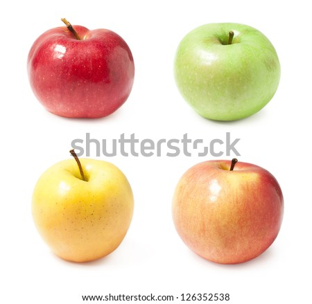 a set of four varieties of apples isolated on white - stock photo