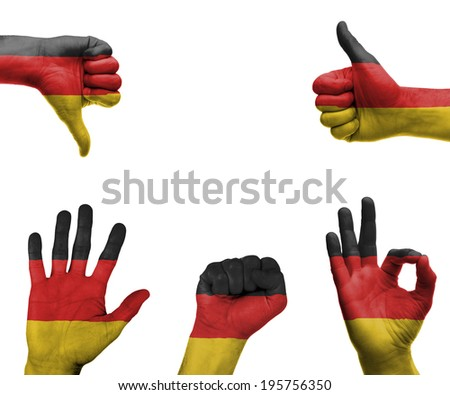 A set of hands with different gestures wrapped in the flag of Germany - stock photo