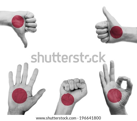 A set of hands with different gestures wrapped in the flag of Japan - stock photo