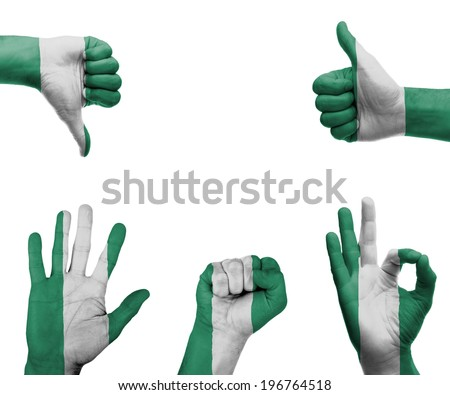 A set of hands with different gestures wrapped in the flag of Nigeria - stock photo