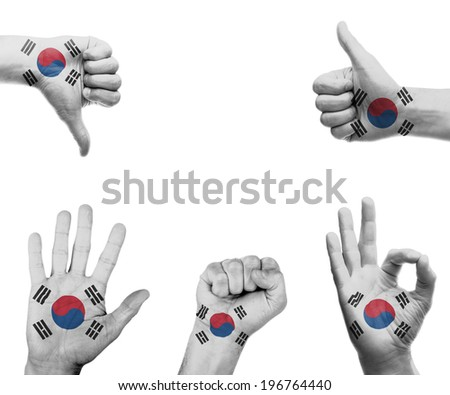 A set of hands with different gestures wrapped in the flag of South Korea - stock photo