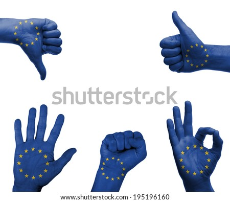 A set of hands with different gestures wrapped in the flag of the EU - stock photo