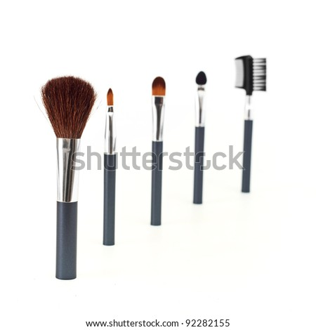 a set of make-up brushes, shot on white background. - stock photo
