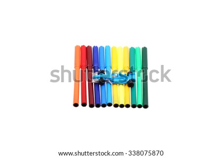 A set of markers and a toy car on top. Isolated on white.                                - stock photo