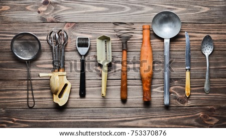 A Set Of Old Kitchen Tools And Cutlery On A Wooden Table. Vintage Cooking In