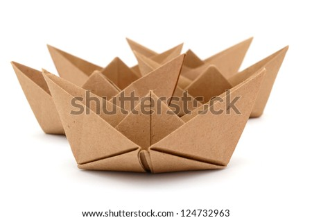 A set of origami boats in recyclable cardboard