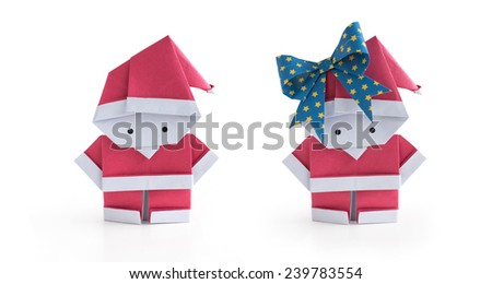 A set of origami paper craft Santa Claus boy and girl isolated on white background - stock photo