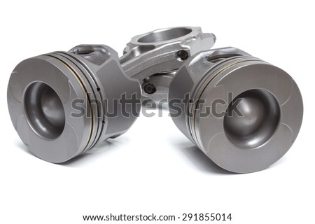 a set of pistons and rods for automobile engine on a white background - stock photo