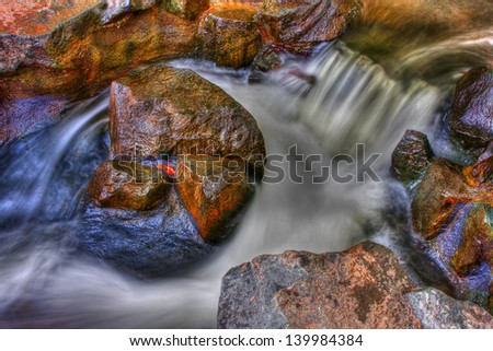 A set of rapids along a small creek in High Dynamic Range - stock photo