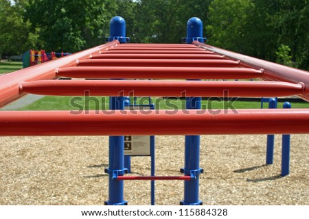 A set of red bars in an empty playground - stock photo