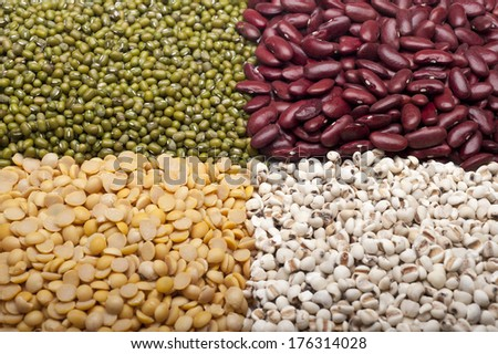 A set of red beans, Soybean, green beans and millet on white. - stock photo