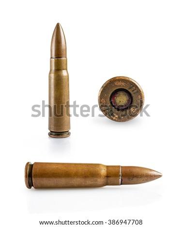A set of rifle cartridges isolated on white - stock photo