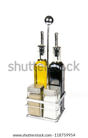 A set of salt pepper olive oil and soya sauce on white background - stock photo