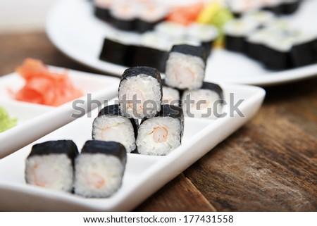 A set of seafood sushi on a plate