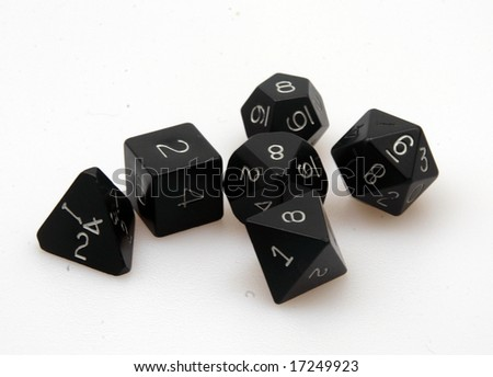 A set of various sided dice mixed up - stock photo