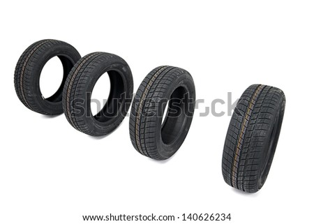 A set of winter tyres on white background - stock photo