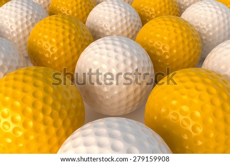 A set of yellow and white golf balls with a nice soft evening lighting set up. - stock photo