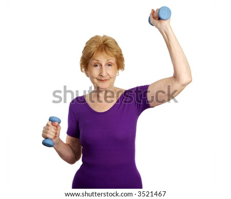 A seventy year old woman smiling and working out with weights.  Isolated on white.