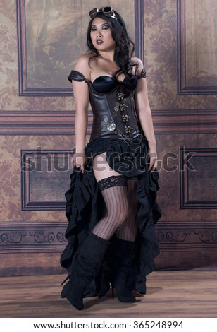 A sexy Asian woman in steampunk garb