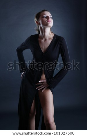 A sexy beautiful girl posing in a studio