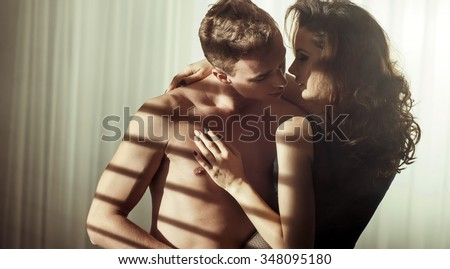 A sexy young topless couple