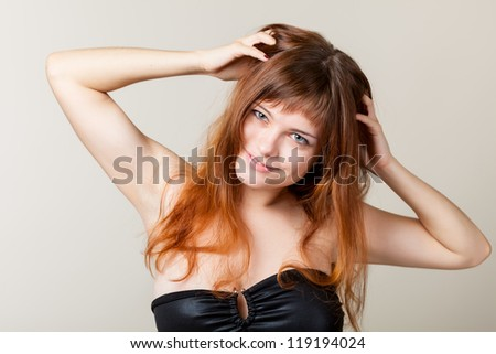 A sexy young woman in a studio
