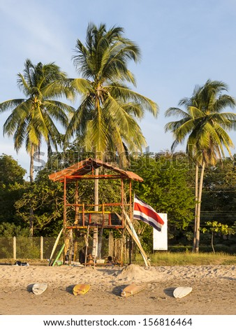 A shack on the beach with lots of surfboards in Tamarindo, Costa Rica - stock photo