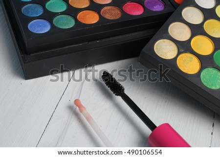 A shadow palette for make-up and face powder, mascara and lipstick pink